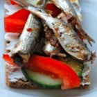 Fresh Sardines Naples Style - Fresh sardines are fried to a crispy golden brown, and drizzled with a garlic and white wine vinaigrette then topped off with a sprinkling of fresh mint leaves. Serve this appetizer with a good white wine.