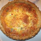 Quiche (Southern Egg Pie) - Spicy sausage, onion and Cheddar join Ranch dressing and hot sauce in this flavorful quiche.