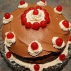 Holly's Black Forest Cake - This is a recipe that is simple to make and always makes people at parties rave.  Garnish with dollops of whipped cream and reserved cherries.