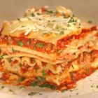 World's Best Lasagna - Filling and satisfying lasagna with sausage, ground beef and three types of cheese.