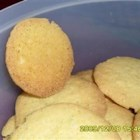 Cornmeal Coconut Cookies - These tender cornmeal cookies have the tropical taste of lime, coconut, and a hint of rum to take your tastebuds on a sunny trip, even in the wintertime.