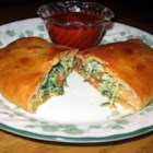 Unbelievable Spinach Calzones - Delicious, satisfying, and very easy to make. My kids will even eat spinach this way! We serve them with warmed spaghetti sauce to dip them in and a salad.  Yum!