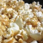 Protein Popcorn - Popcorn is sweetened with corn syrup, honey, sugar, peanut butter, and vanilla in this recipe.