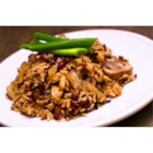 Harvest Rice Dish - Wild rice, brown rice, slivered almonds, fresh mushrooms, and dried cranberries are simmered in seasoned chicken broth in this delicious rice pilaf.