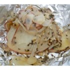 Scalloped Potatoes for the BBQ - Small red potatoes are sliced thinly and layered with chopped, fresh onion, garlic, and basil onto a sheet of aluminum foil. Add a bit of butter, fold up into a sealed packet, and plop onto the grill.