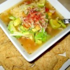 Zeke's Tortilla Soup - An authentic, savory soup from the Mexican food capital of the world - El Paso Texas! You can cut back on some of the fat by baking the tortilla strips instead of deep-frying.