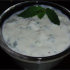 Tzatziki Sauce II - This is a Greek yogurt sauce made with cucumbers and fresh mint. It's perfect for gyros, dipping raw vegetables, etc. Combine chopped onion with the mixture if desired.  Low-fat or nonfat yogurt may be used.