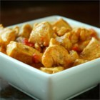 Curried Coconut Chicken - Curried chicken simmered in coconut milk and tomatoes makes for a mouthwatering hint of the tropics! Goes great with rice and vegetables.