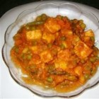 Shahi Paneer - This delightful recipe for cubes of paneer in a tomato-cream sauce is sure to be a nice treat.