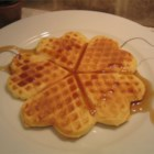 Deluxe Waffles - This recipe yields nicely  'eggy ' waffles that comes out tender and soft, ready to take on butter and syrup.