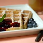 Blueberry Waffles with Fast Blueberry Sauce - Who can resist blueberry waffles with blueberry syrup?