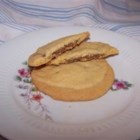 Peanut Butter Chocolate Sandwich Cookies - Melted chocolate is sandwiched between peanut butter cookies.