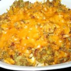 Chicken, Stuffing and Green Bean Casserole - A creamy chicken/green bean mixture topped with stuffing and Cheddar cheese and baked into a simple, lovely dinner.
