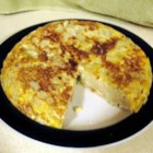 Tortilla de Patata (Spanish Tortilla) - This is a fine Spanish potluck dish that can be served hot or cold, is inexpensive, delicious, and easy to pack. Hope there will be leftovers to take home, but don't count on it.