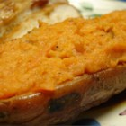 Twice Baked Sweet Potatoes - Sweet potatoes are baked and the flesh is combined with cream cheese, brown sugar, margarine, vanilla extract and walnuts.  Then the skins are filled with the mixture and baked again.
