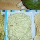 Easy Never Forgotten Guacamole - This guacamole has been a hit at our house for years. Great for the Superbowl or any occasion. Sour cream and cream cheese make the guac extra creamy. Spice it up with crushed red pepper.