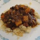 Jacy's Middle-Eastern Fava Bean Stew - A vegetable stew of squash, carrots, bell peppers, fava beans and peas, this recipe is seasoned with the aromatic flavors of Morocco and Lebanon. Serve with steamed basmati rice, couscous or bulgur. For a vegetarian dish, omit the anchovies.