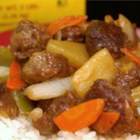 Sweet and Sour Meatballs (Suan T'ien Niu Jou Po Lo La Tzu) - Beef meatballs, carrot, onion and pineapple pieces simmered in a pineapple sweet and sour sauce. Serve hot over steamed white rice.