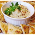 Jalapeno Hummus - Garbanzo beans, jalapeno peppers, garlic, cumin, and tahini combine to make this spicy hummus recipe that will liven up any appetizer table!