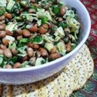 White Bean and Artichoke Salad - Tender white beans and artichoke hearts get a refreshing lift from sweet bell peppers, crisp red onions, olives, parsley, mint and basil. A simple dressing of olive oil and wine vinegar bring the flavors to life.