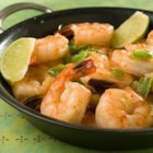 Gambas Pil Pil (Prawns, Chilean Style) - Rich, golden garlic cloves and a splash of pisco flavor juicy prawns in this Chilean version of a classic Spanish tapa.