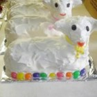 Easter Lamb Cake - White cake mix is baked in a stand up lamb cake mold, frosted with white icing and coated in wooly coconut for an Easter treat.