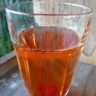 Kir - White wine with a splash of black currant flavored liqueur makes a refreshing drink.
