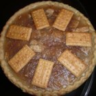 Appleless Apple Pie - A pie shell is filled with a cooked mixture of sugar, cream of tarter and buttery round crackers.  A sprinkling of butter and cinnamon completes the pie.