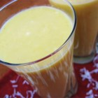 Mango-Pineapple Smoothie - I invented this one day when I had leftover mango and pineapple juice. A spoonful of cream of coconut added the sweetness and special flavor with a tropical flare. You may use frozen pineapple juice ice cubes instead for more of a slush drink (about 8 pineapple ice cubes).  Enjoy!
