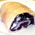 Blueberry Pigs - These little piggies are pie dough rolled up jelly-roll style with blueberries as the filling! Wonderful served warm with milk and sugar.