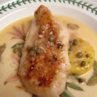 Light Chicken Piccata - This light version of chicken piccata features chicken breasts marinated in yogurt, then fried in margarine and olive oil, and finished in vermouth and lemon juice sauce with capers.