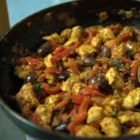 Mediterranean Chicken - The lightness of white wine contrasts with plenty of garlic, onion and herbed tomatoes in this simmered chicken dish highlighted with the piquancy of Kalamata olives.