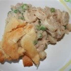 Easy Weeknight Tuna Pot Pie - Refrigerated crescent rolls top a thick and hearty filling of tuna and mixed veggies.