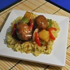 Sweet and Sour Meatballs - Beef meatballs, vegetable and pineapple pieces simmered in a sweet and sour sauce.