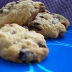 T. T.'s Cookies - Inspired by the love of peanut butter, crisp chocolate chip cookies with a hint of peanut butter.