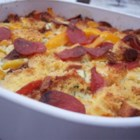 Bacon, Egg, and Cheese Strata - Eggs combine with cheese, bacon, and bread to become a fluffy cheese strata that no one can resist! This is an easy recipe for guys who want to surprise that special someone with breakfast in bed!