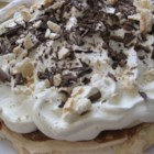 Banoffee Pavlova - A baked meringue is topped with banana slices, caramel sauce and whipped cream. This is a delicious combination of two very yummy desserts making one that will have you making it over and over again!!!