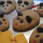 Peanut Butter Christmas Mice - These adorable little cookies are made of creamy peanut butter, butter, sugar, egg and flour.  They are transformed into little mice with peanut halves for ears, green candies for eyes, and red licorice for tails.