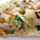 Country Breakfast Casserole - A one-dish casserole with all of your Sunday morning favorites: sausage, gravy, eggs, cheese, and toast.