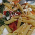 Greek Pasta with Tomatoes and White Beans - Italian-style tomatoes go for a brief simmer with tender white cannellini beans and garden-fresh spinach. Serve over hot penne and spoon crumbled bits of feta cheese over the top for a creamy sharp bite with every mouthful.