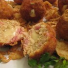 Chicken Cordon Bleu Bites - Appetizer-size ham and chicken meatballs have the surprise of melted Swiss cheese tucked inside. Easy to make, the tasty morsels are coated in bread crumbs, then deep fried and baked.