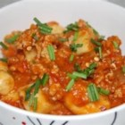 Ricotta Gnocchi - Delicious ricotta cheese gnocchi are covered in a delicious fresh mozzarella-tomato sauce.