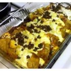 Ground Beef Enchiladas - These are beef filled tortilla shells baked in a creamy chicken soup and cheese sauce.  My husband absolutely loves these. I served them to guests once with Mexican rice, and they went home with the recipe!  Enjoy!
