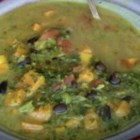 Traci B's Callaloo Soup - This Caribbean soup is so flavorful with its mix of spices that kale, black-eye peas, and coconut milk stand on their own with no meat at all!