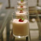 Raspberry White Chocolate Mousse - This is a light and fluffy mousse with a wonderful raspberry sauce. Great layered like a parfait then frozen. Additional Raspberry sauce can be spooned over cakes or served with mousse.
