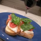 Crostini with Mozzarella and Tomato - I had this in an Italian Restaurant close to home. This is my version. Make extra because these little treats disappear rather quickly.