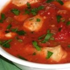 Italian Halibut Chowder - A great soup for a dinner party, Italian Halibut Chowder is seasoned with traditional Italian herbs.  The halibut swims in a tomato-based stock with red peppers, onions and celery.  Delicious garnished with parmesan cheese.