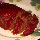 Amish Meatloaf - A recipe for Amish meatloaf topped with bacon strips and a ketchup glaze that I had while in Amish country in Holmes County, Ohio.