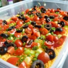 Seven Layer Tex Mex Dip - This super seven layer dip is piled high with Mexican style goodies. Serve it with tortilla chips!
