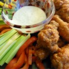 Restaurant-Style Buffalo Chicken Wings - Restaurant-style buffalo chicken wings can be prepared in the comforts of your own home with a few simple ingredients.